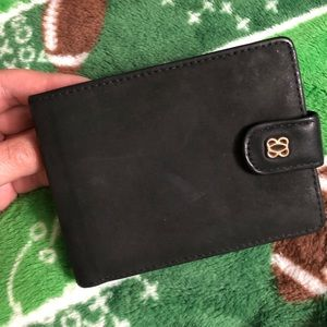 BOSCA Black wallet with gold hardware.